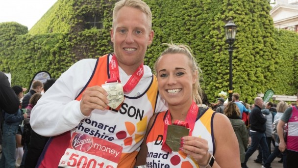 Two of our London Marathon runners with their medals
