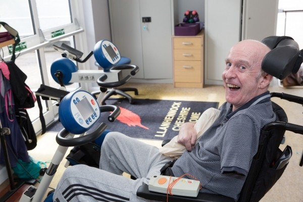 Resident on a exercise bike at Llanhennock lodge
